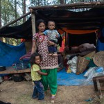 Dolakha: Nepal: 14MAY2015  Indira Pandy lives alone with her two children Inisa, 5 years old, and Ashen, 18 months, under a tarpaulin in a forest. Their village in Dolakha province was totally destroyed in the second earthquake that hit Nepal. She says she is running low on food and her daughter has started wetting the bed because she is traumatised from the earthquakes.