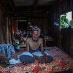 Dolakha: Nepal: 14MAY2015  89 year old Mr Raut rests in the temporary shelter built by his family following the earthquakes. The oxygen canister he uses when he has trouble breathing has long since run out, there is nowhere to get a replacement.
