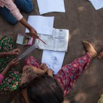 Sindhupawlchok: Nepal: 20MAY2015  Girls at a Save the Children Temporary Learning Centre go through lessons outside of the Sidhiganaesh Primary School. The school's classrooms are no longer usable after the 25 April 2015 earthquake.