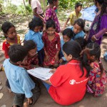 Sindhupawlchok: Nepal: 20MAY2015  Children from the Sidhiganaesh Primary School in Melamchi, Nepal practice reading with materials provided by Save the Children. The school building suffered significant damage in the 25 April 2015 earthquake and is not usable.