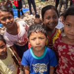 Sindhupawlchok: Nepal: 20MAY2015  Children from the Sidhiganaesh Primary School in Melamchi, Nepal learn outside using materials produced by Save the Children. The school building suffered significant damage in the 25 April 2015 earthquake and is not usable.